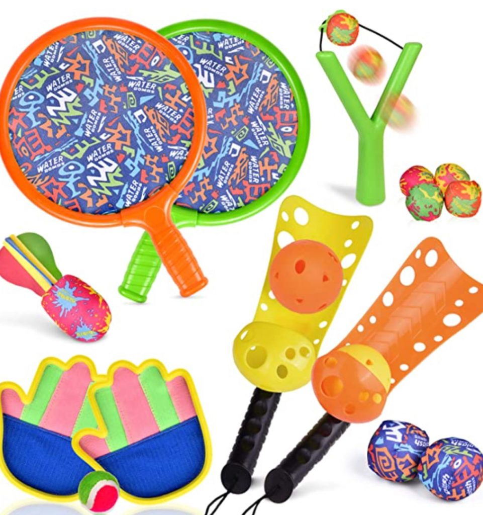 entertain the kids with backyard games, such as paddle ball, scoop ball, and slingshots
