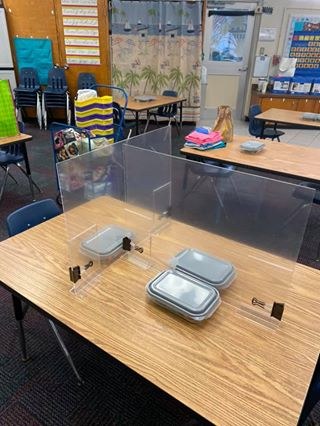 teacher created Plexiglas dividers for students to use when in small groups