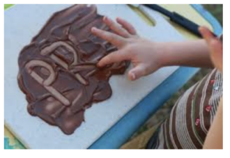 use pudding to finger-write words and letters in